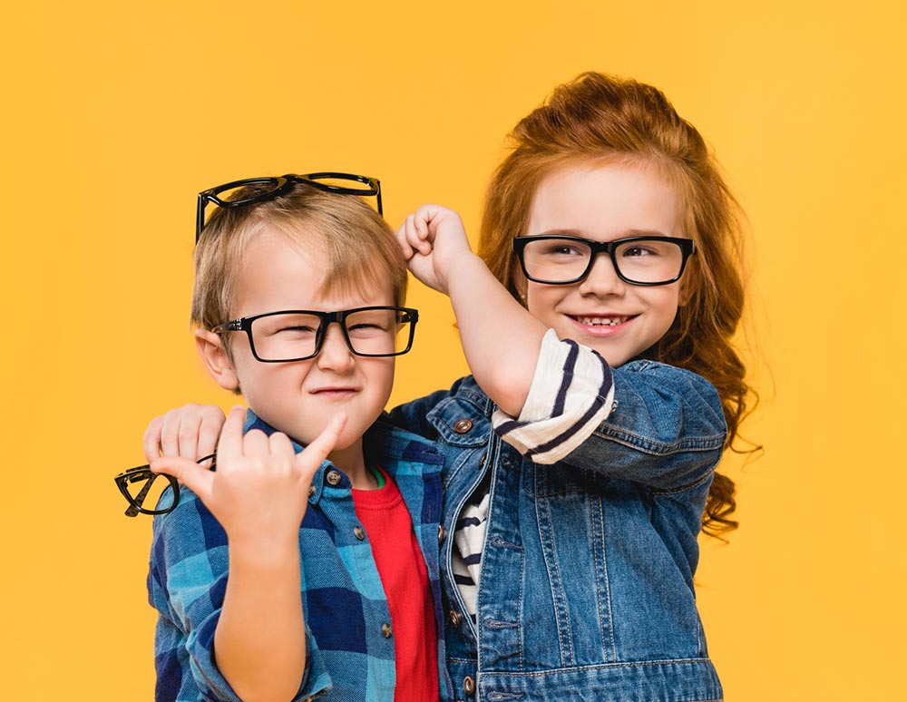 boy and girl with eyeglasses