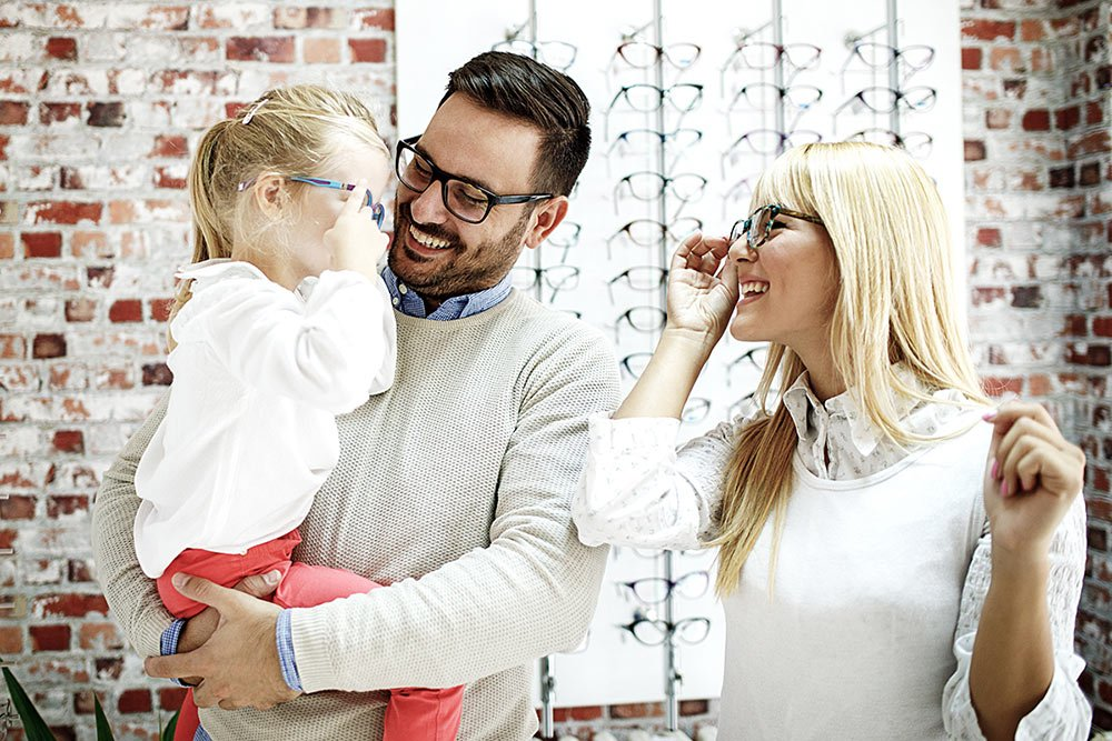 family trying glasses
